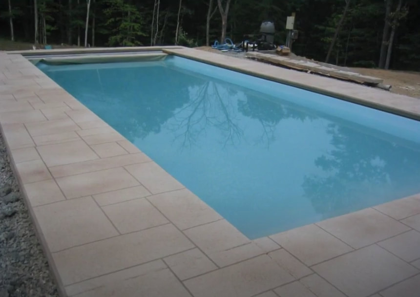 complete stamped concrete pool deck surrounding swimming pool in independence missiouri.