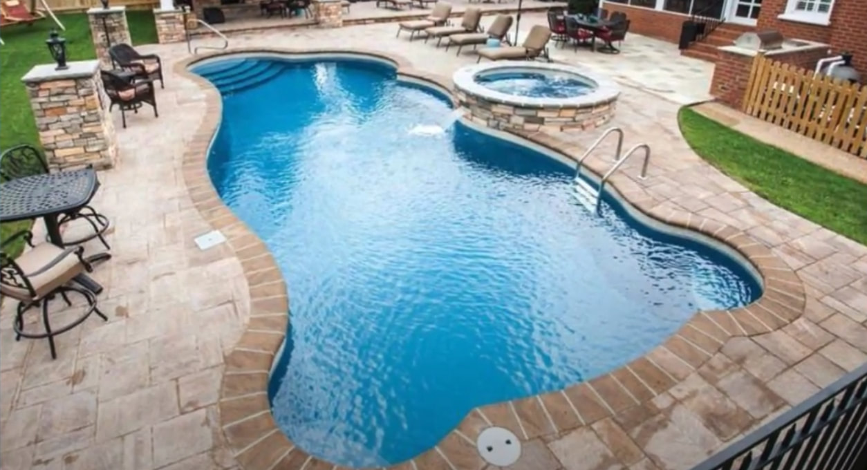stamped concrete deck surrounding a swimming pool in kansas city missouri