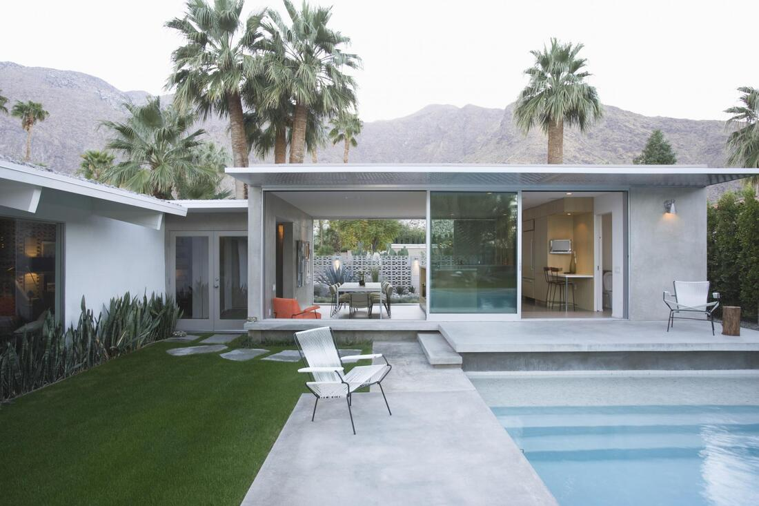 Picture of a beautiful concrete patio and swimming pool